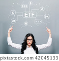 Cryptocurrency ETF theme with business woman pointing upwards 42045133
