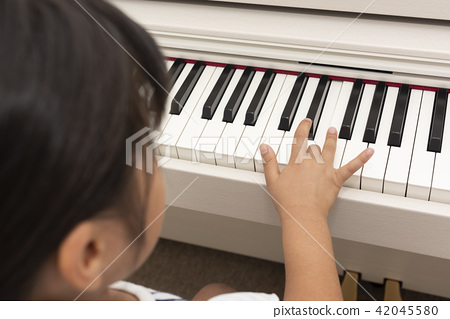 Hand of a girl playing an electronic piano 42045580