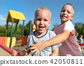 Two little boys playing together and having fun 42050811