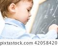 writing boy child 42058420