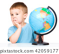 Little boy with a globe 42059177