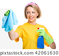 Young woman is cleaning glass using rag 42061630