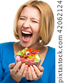 Young happy woman with salad 42062124
