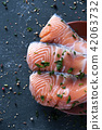 slices of raw salmon 42063732