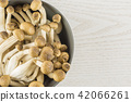 Fresh raw brown shimeji mushroom on grey wood 42066261