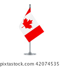 Canadian flag hanging on the metallic pole 42074535