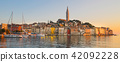 Colorful sunset of Rovinj town, Croatian fishing port on the west coast of the Istrian peninsula. 42092228