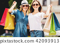 Happy Beautiful Women after Shopping in City. 42093913
