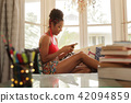 Young Black Woman Texting On Phone And Smiling 42094859