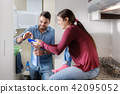 Man And Woman Doing Chores Washing Clothes 42095052