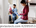 Man And Woman Doing Chores Washing Clothes 42095053