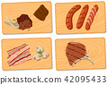 Variety of meat on chopping boards 42095433