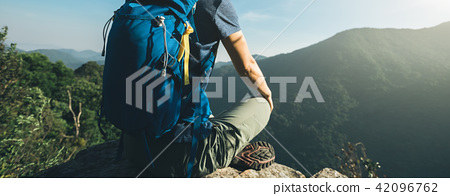 successful hiker sit on mountain top cliff edge 42096762