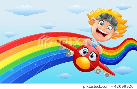 Happy little boy riding a plane in near rainbow 42099920