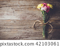 Carnation flowers on wooden table 42103061