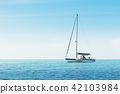Yacht in the sea against blue sky 42103984