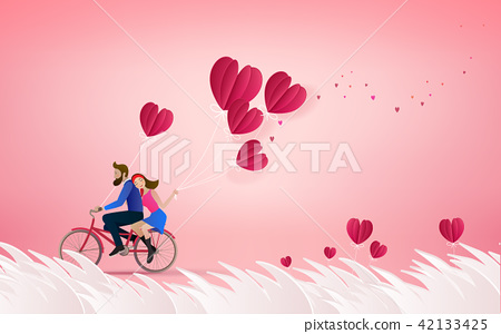 Happy couple is riding a bicycle together 42133425