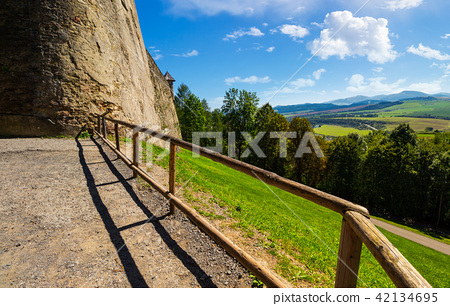 castle wall and railing on a hill 42134695
