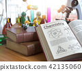 Chemistry education concept. Open books  and flask 42135060