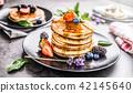 Pancakes with strawberries blackberries blueberrie 42145640