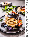 Pancakes with strawberries blackberries blueberrie 42145643