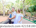 parents with toddler girl child having fun in  zoo 42158180