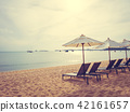 Umbrella and chair on the tropical beach sea and ocean at sunrise time 42161657
