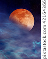 Red moon with many stars and clouds on night sky. 42164366
