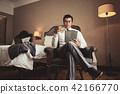 Businessman resting in hotel room 42166770