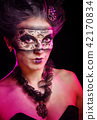 Girl in masquerade mask 42170834