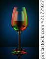 Coloful wineglass on table. 42172927