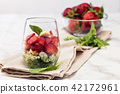 Spinach salad in glass. 42172961