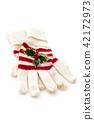 Winter gloves on white. 42172973