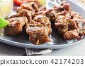 Pork satay with peanut sauce and vegetables 42174203
