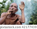 Older men are smoking. 42177439