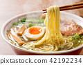 Picking hot soy sauce ramen with chopsticks 42192234