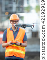 Engineer man flying drone over construction site 42192919