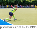 Young hockey player girl performing penalty shot 42193995