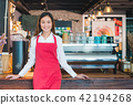 Asian female barista at counter bar with smile 42194268