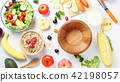 empty wooden bowl and mixed vegetables salad 42198057