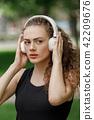 headphone, park, woman 42209676