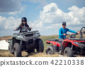 Friends driving off-road with quad bike or ATV and UTV vehicles 42210338