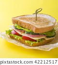 Sandwich with cheese, ham and fresh vegetables 42212517