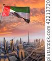 Dubai against sunset in United Arab Emirates 42213720