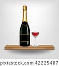 Bottle green wine and glass on wood shelf 42225487