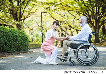 Nursing care senior female male helper caregiver 42227354