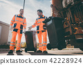 Garbage removal men working for a public utility 42228924