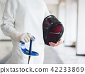 fencer in white fencing suit and holding mask and 42233869