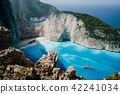 Navagio beach or Shipwreck bay with turquoise water and pebble white beach. Famous landmark location 42241034