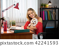 Portrait Business Woman Working With Pet Dog In Office 42241593